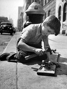 Kid Building Vintage Skateboard | four clay wheels