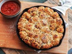 Pull-apart Garlic Knots (http://www.seriouseats.com/2014/09/cast-iron-pull-apart-pepperoni-garlic-knots.html)