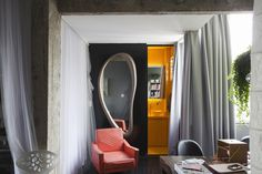 Freunde von Freunden — Guto Requena — Architect and Designer, Apartment, Sao Paulo — http://www.freundevonfreunden.com/interviews/guto #interior #mirror #orange #armchair