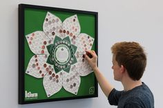 Kiva Donation Board by Mark Wilson #mark #frame #interactive #kiva #money #infographic #design #charity #wilson #advertising #donation #promotion #lotus #coins