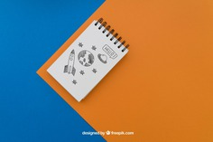 Notepad on blue and orange background Free Psd. See more inspiration related to Background, Paper, Blue, Orange, Doodle, Notebook, Note, Sketch, Drawing, Clean, Draw, Notepad, Sketchy and Note paper on Freepik.