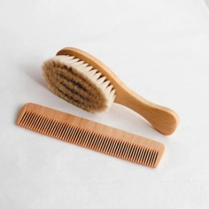 This hairbrush and comb set is beautifully crafted from beechwood using traditional techniques. The hairbrush's dreamy soft bristles are made from natural goat's hair to gently care for your baby's wispy hair and delicate scalp, while the fine-toothed wooden comb works to smoothen hair. Made in the Black Forest in Germany.