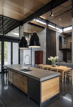 Double Height Living Spaces Add Drama to This Industrial-Style House 7