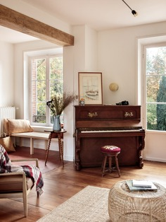 """The house had been last occupied in the 1970s and was left furnished. Feilders kept the best pieces, including this piano, a 130-year-old Gabriel Gavreau (""""it's newly tuned; we're waiting for Elton John to stop by""""), and mixed the antiques with pale modernist designs."""
