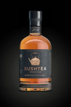 Bushtea Spiced Rum #rum #england #bottle #spirits #packaging #craft #black #gold #foil