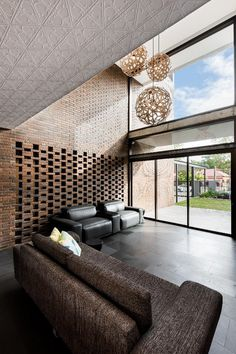 Impressive Brick Home with Open and Glazed Living Spaces 2