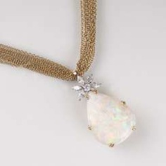 Opal and diamond pendant with chain