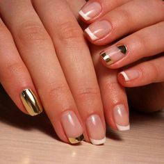 Glamorous looking French tips in clear, white and metallic polish.