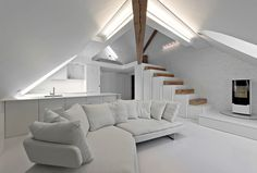 Softdecor Created Well Balanced Mezzanine Apartment in White - InteriorZine
