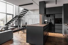 Instantly Captivating Wood and Graphite Apartment in Poznan by Metaforma
