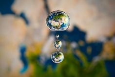 Miniature Liquid Worlds by Markus Reugels | Colossal #water #world #map #drop #waterdrop