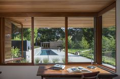 Channeling Midcentury Modern in Northern California - Photo 3 of 7 - Looking out from one of the home offices, Â a board-formed concrete gar