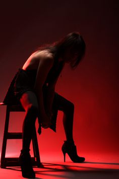 red lighting woman stool