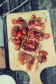 grilled salmon . cherry tomatoes