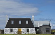 Modern Curved Roof House with Cottage-Like Addition in Scotland