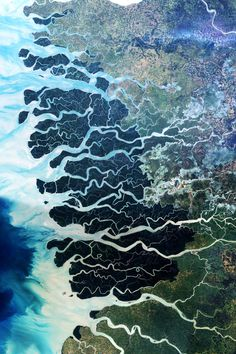 The Sundarbans is the largest single block of tidal halophytic mangrove forest in the world which covers parts of India and Bangladesh by NA #water #aerial #landscape #earth #photography #nature #floodplain #river #beauty