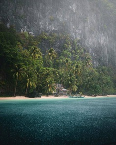 "Tropical rains in #Palawan 🌴""There is nothing more magical then being on a tropical beach while it's pouring with rain. This day was one to remember. "" (📷: @kayvanhuisseling 📍: El Nido, Palawan) by @beautifuldestinations"