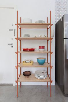 Shelving unit made of iron bars and plywood. Ap Cobogó by Alan Chu. #alanchu #minimalism #shelvingunit