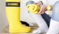 Foldable yellow rain boots