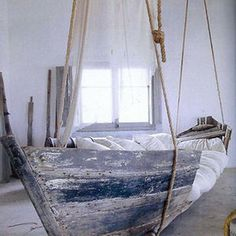 Old Boat Turned Into Hanging Bed
