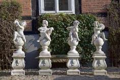 Four putti sculptures as the musicians