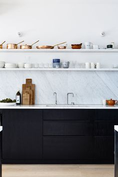 #Blackandwhite #kitchen. #StVincentPlaceHouseII by #OConnorAndHouleArchitecture. Photo by #DerekSwalwell. #marblebacksplash #kitchencabinet