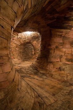 Henrique Oliveira Constructs a Cavernous Network of Repurposed Wood Tunnels at MAC USP