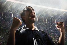 Cheering athlete in sports stadium