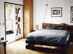 Crammed up furniture in your room? You can always use a retractable bed which hides and folds up to the ceiling until bed time, saving a lot #design #home #product #furniture #industrial