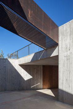 #Concrete #warehouse and steel #bridge. Farm Surroundings by Arnau Estudi d'Arquitectura. Photo by Marc Torra.
