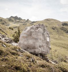 bureau A sites stone-shaped wooden cabin in the swiss alps