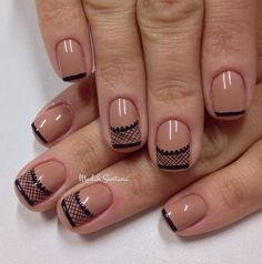 Nude and black lace inspired nail art design. Make your nude nail polish unique by adding lace details on the tips using thin strokes of bla