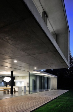 Contemporary Lake House Made Entirely of Raw Concrete 10