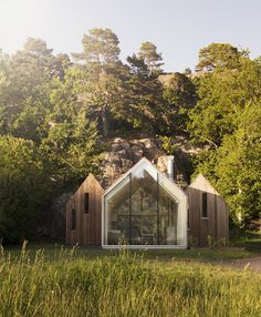 Cluster of Wooden Cabins by Reiulf Ramstad