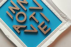 Leeds & Partners #frame #lettering #cut #laser #wood #passport #innovative #typography