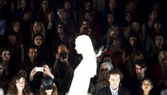 Audience members watch a model during the J. Mendel Spring/Summer 2013 show at New York Fashion Week