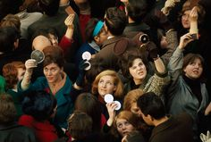 Women use compact mirrors in packed crowd to catch sight of the queen in London, June 1966. #angle #photography