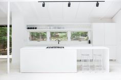 White kitchen with black accents. Red Dirt Rd House by Amee Allsop. #kitchen #minimalism #ameeallsop