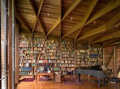 Library shelving and structure as one #wood #architecture