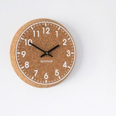 Cork Clock The Cork Clock is a highly durable, eco-friendly, and sustainable clock. It is made from the outer bark of a cork oak tree, which can only be harvested every 9-14 years, making it a great alternative to a classic wall clock. Designed and made in the UK.