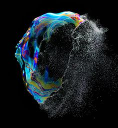 Iridient No. 03 (2012) A floating soap bubble is captured at the moment it bursts, and surface tension is broken. #colors