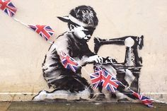 Banksy's Union Jack Child Labor Stencil in London | Hypebeast #union #banksy #child #elizabeth #jack #art #street #queen