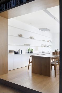 Alfred Street Residence is a minimalist house located in Prahran, Australia, designed by studiofour. A restrained material palette of white #interior #design