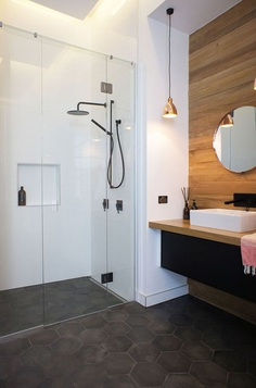Bathroom Tile Ideas - Grey Hexagon Tiles // Dark grey hexagon tiles on this bathroom floor partnered with the wood paneled feature wall make the space feel modern and inviting.