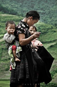 A tribe women sewing for her child - taken in the North of Vietnam