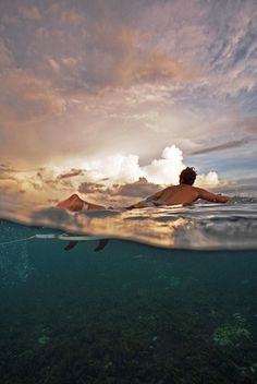Paddling out to the setting sun #ocean #sunset #underwater #surf