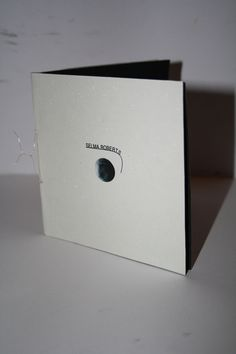 Self promotion (second year) #front #white #promotion #self #bound #design #graphic #book #black #circles #mirror #illustration #identity #wire #and #logo #booklet #mailer #spotlight #spot