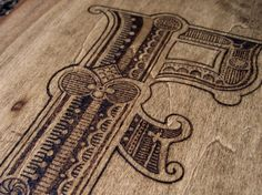 grayhood » Blog Archive » wood burned e - dan gneiding graphic design #burn #type #letter #wood