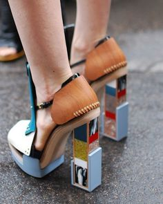 A unique pair of Balenciaga shoes brings light to the rainy pavement #balenciaga #heels