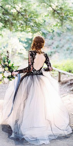 Black color suits the most courageous and brisk fashionistas. Brave, chic and darling brides choose black wedding dresses for an incredible wedding day.